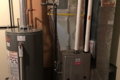 Bryant gas furnace and Rheem gas hot water tank